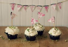 chocolate olive oil cupcakes with goat cheese frosting and pistachios