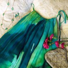 BCBG watercolor dress Halter neck BCBG with cute string tie at shoulder. Balloon bottom. BCBGMaxAzria Dresses
