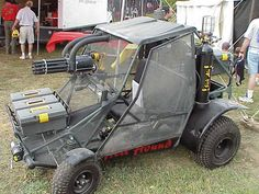 front passenger side holds a 10 barrel cannon that sends 50 rds per sec. down range along with a remotely operated grenade launcher that sits in the back, on vehicle central air system and can carry about 12000 rds of paint   yes i do want