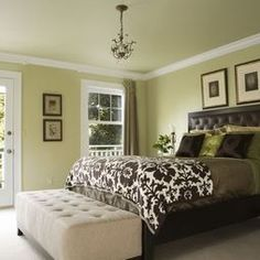 Color Of Bedroom double-hung windows welcome natural light in to illuminate the
