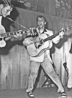 Rock and roll singer Elvis Presley performs on stage with his brand new Martin acoustic guitar and Scotty Moore on the left on July 1955 at Fort Homer Hesterly Armory in Tampa, Florida. Rock And Roll, Rock N, Live Rock, A Saucerful Of Secrets, Genre Musical, Music Genre, Folk Music, Music Music, Music Stuff