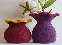 """These felted wool vases with the voluptuous shapes are knitted in the round, then felted in a washing machine. They may be used with fresh flowers, hand crafted flowers or a potted plant. For fresh flowers, simply slip a glass inside and fill with water. The opening at the top will accommodate a 3"""" diameter pot or glass."""