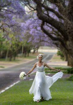 Bride with Jacaranda trees, Pretoria. Jacaranda Trees, Girls Dresses, Flower Girl Dresses, Pretoria, Bride, Wedding Dresses, Flowers, People, Fashion
