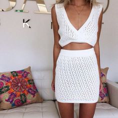 All white everything: white, crochet top, knitwear, white crop top, white crochet skirt, on point clothing, mini skirt, body chain, summer, summer outfits, pretty, girly, blonde hair, fashionista,  tan, tumblr, skirt and top, pillow, plung neckline, matching skirt and top, matching set, crop tops - Wheretoget
