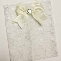 Elegant white lace boot cuffs with classy bow.  These will match any outfit!!!  Www.etsy.com/shop/MostBeautifulDesigns
