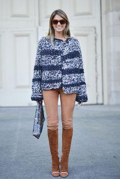 Helena Bordon wearing a Chloé jumper, Valentino bag, and Loewe boots.  Image Source: Getty / Vanni Bassetti