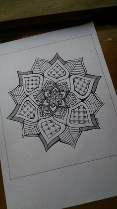 Unique mandala design, drawn in ink pen and printed on glossy photo paper. This design took about half an hour to forty minutes to complete,
