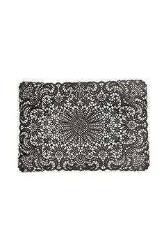 Black doily place mat with lace design from Urban Outfitters ($4).