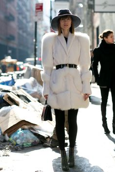 SHOP THE LOOK:   NYFW live: Anya's white fur  Anya Ziourova is looking fabulous in her fluffy white coat worn with edgy accessories in New York.