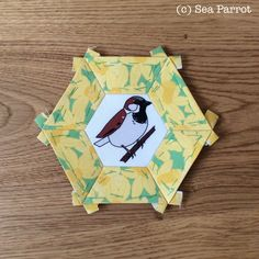 House sparrow bird and daffodil fabric hexie patchwork block. Original fabric designs from Sea Parrot available in my online shop or contact me directly. House Sparrow, Sparrow Bird, Bird Quilt, Patchwork Fabric, Bird Art, Daffodils, Textile Art, Parrot, Fabric Design