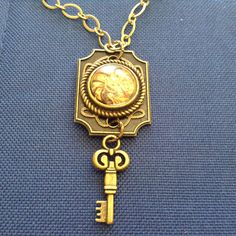 Steampunk keyhole with 18mm cabochon and key necklace by CutesyandFun on Etsy