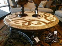 What a gorgeous statement for your room. Stunning, Thomasville coffee table with swirled stone top. Measures 51*20.
