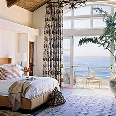 Scenic Haven...  Natural tones and a muted color palette create a peaceful sanctuary, allowing a breathtaking view to take center stage. An exposed wooden ceiling adds rustic warmth.