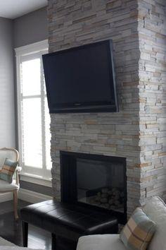 tv over fireplace with ledgestone mantel