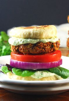"A juicy, spicy vegan tandoori naan burger sandwiched in a naan bread ""bun"". Serve with coriander tofu raita instead of mayo. Burger Recipes, Veggie Recipes, Indian Food Recipes, Vegetarian Recipes, Cooking Recipes, Ethnic Recipes, Vegan Meals, Bread Recipes, Naan"