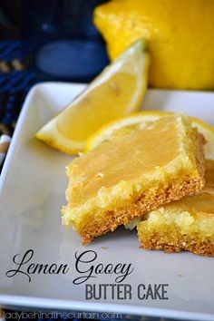 This Lemon Gooey Butter Cake totally lives up to it's name.  With a wonderful almost cookie like crust, creamy center and crunchy top.  Delish! Lady Behind The Curtain