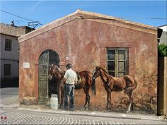 A mural on a house appears to show a man letting his horses in at a side door. Street Wall Art, Graffiti Wall Art, Murals Street Art, Art Mural, Mural Painting, Street Art Graffiti, Paintings, Amazing Street Art, Amazing Art
