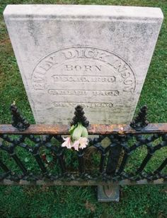 "Emily Dickinson died from nephritis on May 15, 1886. She was buried, laid in a white coffin with vanilla-scented heliotrope, a Lady's Slipper orchid, and a ""knot of blue field violets"" placed about it. The funeral service, held in the Homestead's library, was simple and short. Higginson, the minister, who had met her only twice, read ""No Coward Soul Is Mine"", a poem by Emily Brontë that had been a favorite of Dickinson's."