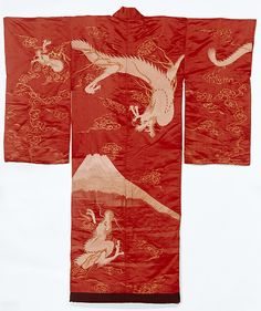 1850-1880 This kimono has been embroidered with an extremely potent image of dragons, the most powerful of the mythical beasts, and Mt Fuji, the quintessential symbol of Japan. The striking red silk ground makes the image all the more dramatic.Yet this is an under-kimono (juban), so its design would not have been seen when worn. Instead it served to symbolically wrap the wearer with divine power and protection.