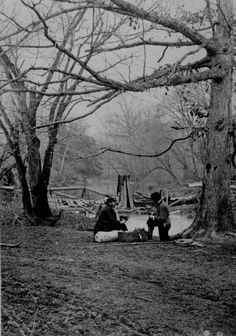 Two photographers having lunch in the Bull Run area before the second battle, 1862