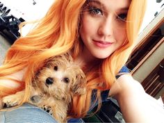 I'm lonely and want cuddles,but it doesn't matter. *sighs then smiles* Anyway,I got a puppy I named her Sabrina. *smiles and just looks down while playing with her*- Katherine