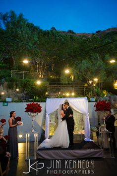 Amazing first kiss during the nightime ceremony at this Seven Degrees Laguna Beach Wedding | Jim Kennedy Photographers
