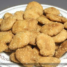 Sweet mathri is a traditional deep fried snack flavored with sesame seeds.  Recipe in English - http://indiangoodfood.com/1382-sweet-mathri-recipe.html( copy and paste link into browser)