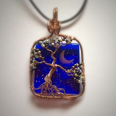 Fused glass, wire wrapped, tree of life pendant. NeverKnow Creations