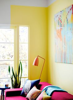 Color blocked painted wall makes for an unexpected detail in this bright living room -Dulux Forecast
