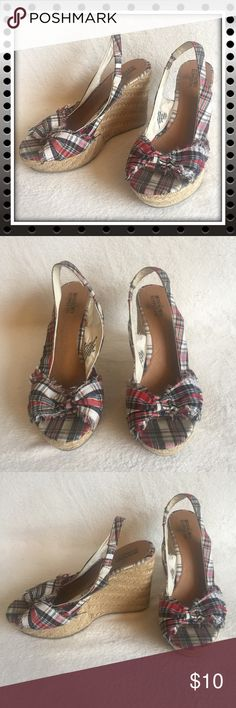 "Plaid Bow Wedges Mossimo Supply Co. brand. Size 8.5. Cute plaid (red, blue, white, and yellow) slingback espadrille slip ons with a nonslip sole and a bow over the toe. Natural grass braided wedge overlay and frayed fabric finish on the body. Only worn a few times, soles are slightly worn and bottom of shoes hardly show any signs of wear.   Measurements (approximate): Heel: 4.5"" Toe raise: 1.5"" Mossimo Supply Co. Shoes Wedges"