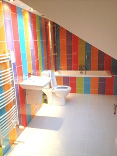 Multi coloured bathroom tiles, although I'm planning on custom glass panels, same width, in multi colour