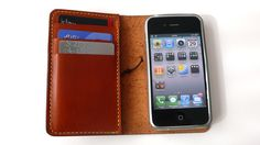 (need an iPhone 5 version when it comes out) Hand-Stitched iPHONE 4 / 4S WALLET with a Silicone Case (Free Monogramming). $60.00, via Etsy.
