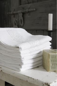 stacks of white towels ✔