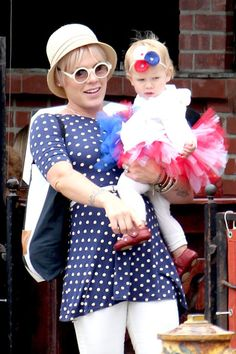 "Pink and her 13-month-old daughter Willow showed some adorable holiday spirit. The ""So What"" singer went for blue-and-white polka dots, while her mini-me complimented her in red and white ... and a too-cute tutu ... during a family celebration in Los Angeles."