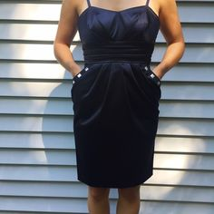 Black Formal Party Dress Gently used. Stud detailing around pockets in front. Bow ties in back. Zipper closure in back. Straps adjustable. BCX Dresses Prom