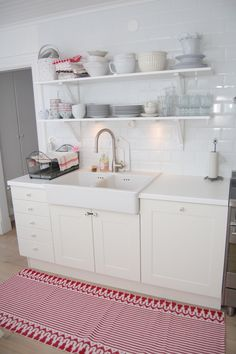 love the farm sink and the pop of color against the white