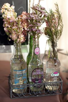 would be cool for an outdoor wedding and you could easily add flair by using more dramatic flowers - tulips, peonies in bold colors would be awesome in these bottles