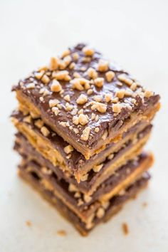 Graham Cracker Toffee (aka Graham Cracker CRACK) - Sweet, buttery, caramely, perfectly chocolaty, topped with toffee bits for extra crunch!! Lives up to its name and extremely ADDICTIVE!! An EASY holiday and party FAVORITE!!