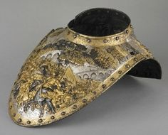 hismarmorealcalm:  Gorget (throat collar)  Unknown artist  Milan  circa 1610  Iron or steel, gold, copper alloy, and silver, embossed, blued, incised, chased, plated and gilded