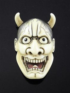 A Japanese ivory noh mask netsuke of Hannya, Meiji period, engraved three character signature, 5.8cm.