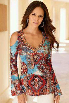 060e9f6a4432a1 Our wear-now scarf print tunic top inspires wanderlust with its colorful  desert hues. Our knit top is detailed with sexy cold-shoulder cutouts, ...