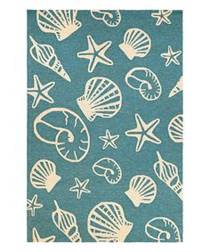 This Turquoise & Ivory Outdoor Escape Cardita Shells Rug is perfect! #zulilyfinds