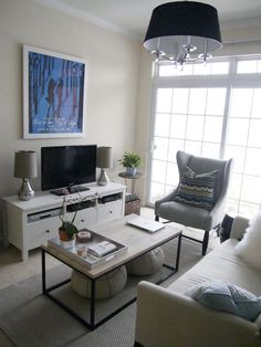 Small living room solutions for furniture placement. TV stand and accessories.