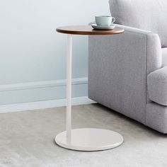 Just like its namesake, the Ruby C-Side Table stands out. A disc-shaped base and a haze-finished metal frame combine to create a piece that instantly makes a room feel special. Its airy, C-shaped frame slips easily beneath sofas and chairs to maxi… Rustic Side Table, White Side Tables, Modern Side Table, Narrow Side Table, C Table, Drink Table, Tree Stump Side Table, Room Planning, My Living Room