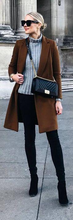 brown jacket grey sweater black pants