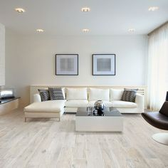 Our white oak Memory Bianco wood effect porcelain floor tiles perfectly compliment the cool tones of this contemporary lounge. Wood Effect Floor Tiles, Wood Effect Porcelain Tiles, Wood Tile Floors, Porcelain Floor, Parquet Tiles, White Wood Floors, Parquet Flooring, Style At Home, Contemporary Lounge