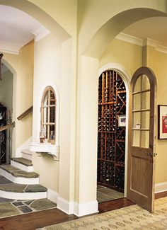 Use the space around a staircase for a wine cellar