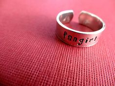 Fangirl Ring - Personalized Stamped Ring - Fandom Jewelry - 1/4 Band by TesoroJewelry on Etsy https://www.etsy.com/listing/165594529/fangirl-ring-personalized-stamped-ring