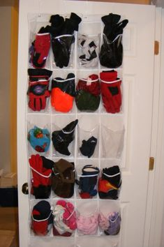 Great way to stay organized this winter...over the door shoe holder holds mittens, gloves, hats, and scarves! Can use a Sharpie to personalize the pockets with the names of family members.