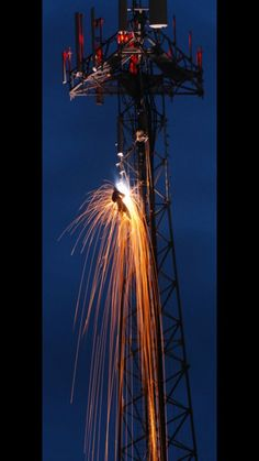 Welding on a tower at night.